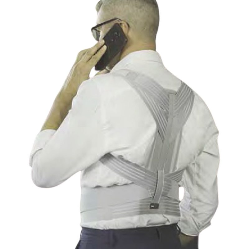 Man wearing posture corrector talking on the phone